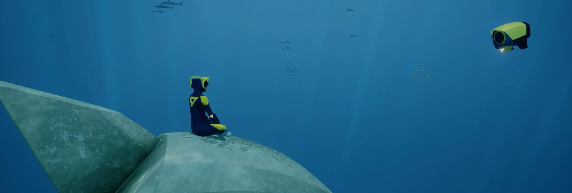 Szene aus Abzu. Die Spielfigur sitzt unter Wasser meditierend auf einem Stein.